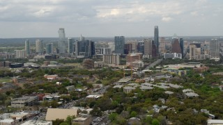 DX0002_103_018 - 5.7K stock footage aerial video of a reverse view of the city's skyline in Downtown Austin, Texas