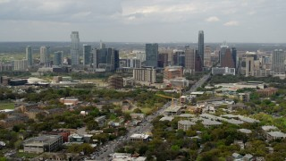 DX0002_103_023 - 5.7K stock footage aerial video wide view of Congress Avenue leading to city's skyline in Downtown Austin, Texas