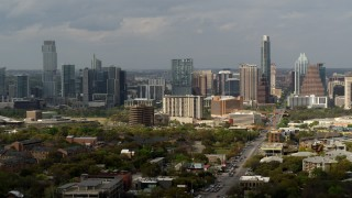 DX0002_103_033 - 5.7K stock footage aerial video descend by Congress Avenue leading to the city's skyline and state capitol, Downtown Austin, Texas