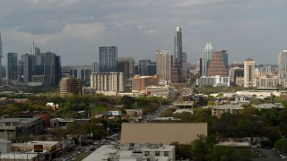 DX0002_103_034 - 5.7K stock footage aerial video ascend and flyby skyscrapers in the city's skylinel, Downtown Austin, Texas