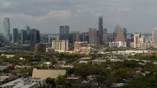 DX0002_103_035 - 5.7K stock footage aerial video reverse view and flyby of the city's skyline, Downtown Austin, Texas