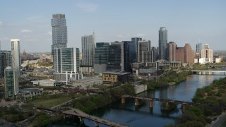 DX0002_104_001 - 5.7K stock footage aerial video flying by skyscrapers and bridges spanning Lady Bird Lake, Downtown Austin, Texas