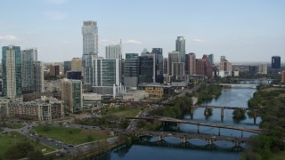 DX0002_104_008 - 5.7K stock footage aerial video reverse view of tall skyscrapers and bridges over Lady Bird Lake, Downtown Austin, Texas