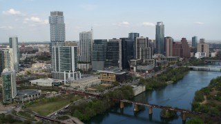DX0002_104_011 - 5.7K stock footage aerial video ascend and flyby towering skyscrapers and bridges over Lady Bird Lake, Downtown Austin, Texas