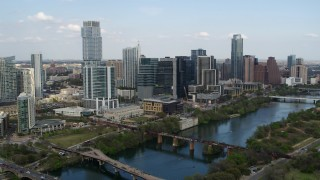 DX0002_104_012 - 5.7K stock footage aerial video approaching towering skyscrapers and bridges over Lady Bird Lake, Downtown Austin, Texas