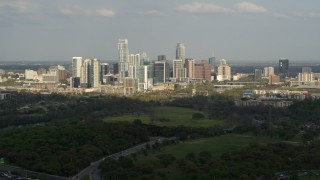 DX0002_104_019 - 5.7K stock footage aerial video of a wide view of city's towering skyline and Lady Bird Lake, Downtown Austin, Texas