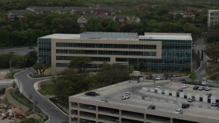 DX0002_104_028 - 5.7K stock footage aerial video of circling a modern office building in Austin, Texas