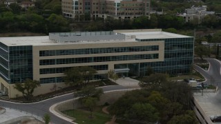 DX0002_104_029 - 5.7K stock footage aerial video approach and orbit a modern office building in Austin, Texas