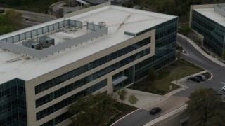 DX0002_104_030 - 5.7K stock footage aerial video of slow orbit around a modern office building in Austin, Texas