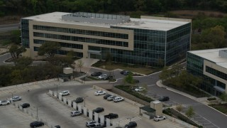DX0002_104_031 - 5.7K stock footage aerial video of slowly circling around a modern office building in Austin, Texas