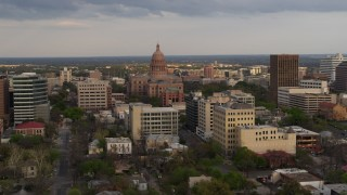 DX0002_104_033 - 5.7K stock footage aerial video of flying by the Texas State Capitol building at sunset in Downtown Austin, Texas