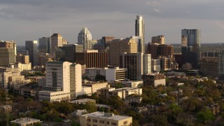 DX0002_104_044 - 5.7K stock footage aerial video ascend and approach courthouse, office buildings near skyscrapers at sunset in Downtown Austin, Texas
