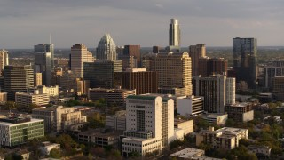 DX0002_104_045 - 5.7K stock footage aerial video passing courthouse near office buildings and skyscrapers at sunset in Downtown Austin, Texas