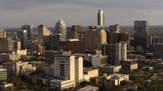 DX0002_104_046 - 5.7K stock footage aerial video flyby courthouse and office buildings near skyscrapers at sunset in Downtown Austin, Texas