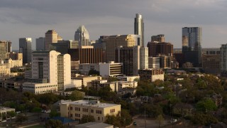 DX0002_104_047 - 5.7K stock footage aerial video of office buildings and skyscrapers near courthouse at sunset in Downtown Austin, Texas
