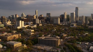 DX0002_105_003 - 5.7K stock footage aerial video of flying away from skyscrapers and office buildings at sunset in Downtown Austin, Texas