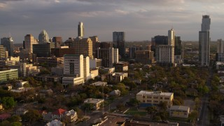 DX0002_105_009 - 5.7K stock footage aerial video of office buildings and skyscrapers behind courthouse at sunset in Downtown Austin, Texas