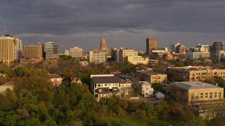 DX0002_105_013 - 5.7K stock footage aerial video Texas State Capitol dome and office buildings at sunset in Downtown Austin, Texas