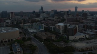 DX0002_105_018 - 5.7K stock footage aerial video reverse view of hospital, skyscrapers and capitol dome at sunset in Downtown Austin, Texas