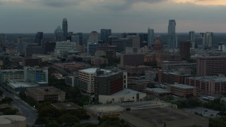 DX0002_105_023 - 5.7K stock footage aerial video of office buildings and capitol dome at sunset, skyscrapers in distance in Downtown Austin, Texas