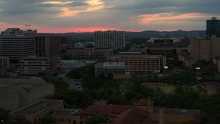 DX0002_105_027 - 5.7K stock footage aerial video of the setting sun while passing near the university, Austin, Texas