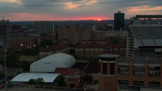 DX0002_105_030 - 5.7K stock footage aerial video of descending by the university campus with setting sun in distance, Austin, Texas