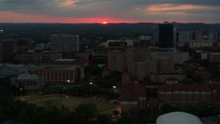 DX0002_105_033 - 5.7K stock footage aerial video flyby the university campus with setting sun in distance, Austin, Texas
