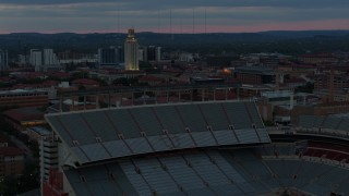 DX0002_105_035 - 5.7K stock footage aerial video of UT Tower at the University of Texas at twilight, Austin, Texas