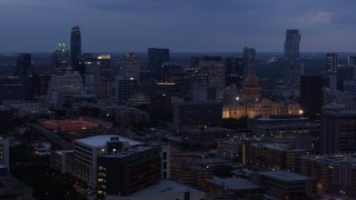 DX0002_105_045 - 5.7K stock footage aerial video of passing by office buildings, capitol and skyscrapers at twilight in Downtown Austin, Texas