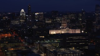 DX0002_106_003 - 5.7K stock footage aerial video reverse view of office buildings, skyscrapers and capitol at night in Downtown Austin, Texas