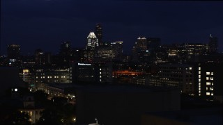 DX0002_106_006 - 5.7K stock footage aerial video ascend and approach office buildings, skyscrapers at night in Downtown Austin, Texas