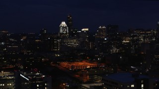 DX0002_106_007 - 5.7K stock footage aerial video of passing office buildings, skyscrapers at night in Downtown Austin, Texas