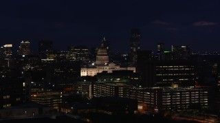 DX0002_106_009 - 5.7K stock footage aerial video of flying by the Texas State Capitol at night in Downtown Austin, Texas