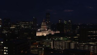 DX0002_106_010 - 5.7K stock footage aerial video of slowly ascending toward the Texas State Capitol at night in Downtown Austin, Texas
