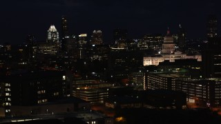 DX0002_106_013 - 5.7K stock footage aerial video slow pass by skyscrapers, office buildings, Texas State Capitol at night in Downtown Austin, Texas
