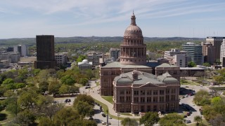 DX0002_107_003 - 5.7K stock footage aerial video slowly orbit the Texas State Capitol in Downtown Austin, Texas