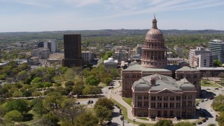 DX0002_107_004 - 5.7K stock footage aerial video of orbiting the Texas State Capitol and grounds in Downtown Austin, Texas