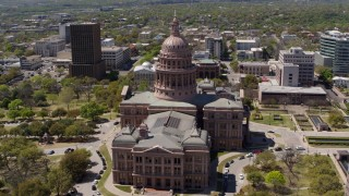 DX0002_107_008 - 5.7K stock footage aerial video of an orbit around the side of Texas State Capitol and grounds in Downtown Austin, Texas