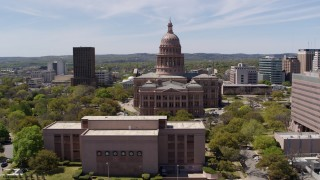 DX0002_107_012 - 5.7K stock footage aerial video descend behind library with view of Texas State Capitol in Downtown Austin, Texas