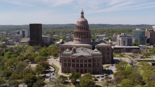 DX0002_107_013 - 5.7K stock footage aerial video ascend over library for view of Texas State Capitol in Downtown Austin, Texas