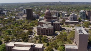 DX0002_107_015 - 5.7K stock footage aerial video of a wide orbit around the Texas State Capitol dome and grounds in Downtown Austin, Texas