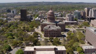DX0002_107_016 - 5.7K stock footage aerial video of orbiting around the Texas State Capitol dome and grounds in Downtown Austin, Texas