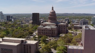 DX0002_107_018 - 5.7K stock footage aerial video approach the Texas State Capitol dome from library and orbit in Downtown Austin, Texas