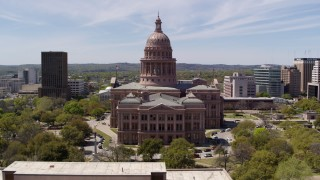 DX0002_107_020 - 5.7K stock footage aerial video fly over library and approach the Texas State Capitol building in Downtown Austin, Texas