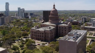 DX0002_107_022 - 5.7K stock footage aerial video of circling the Texas State Capitol building in Downtown Austin, Texas
