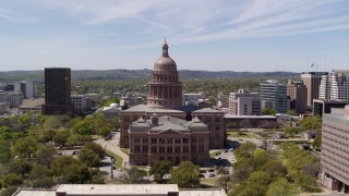 DX0002_107_029 - 5.7K stock footage aerial video fly over library toward Texas State Capitol, Downtown Austin, Texas