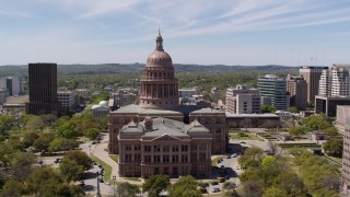 DX0002_107_030 - 5.7K stock footage aerial video descending while focused on the Texas State Capitol, Downtown Austin, Texas