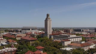 DX0002_107_031 - 5.7K stock footage aerial video orbit UT Tower at the University of Texas during ascent, Austin, Texas