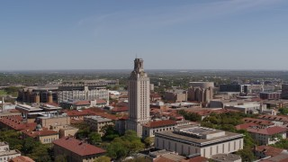 DX0002_107_033 - 5.7K stock footage aerial video orbit UT Tower at the University of Texas during descent, Austin, Texas