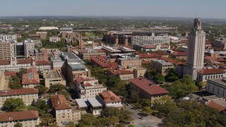 DX0002_107_044 - 5.7K stock footage aerial video of descending by campus buildings and UT Tower at the University of Texas, Austin, Texas